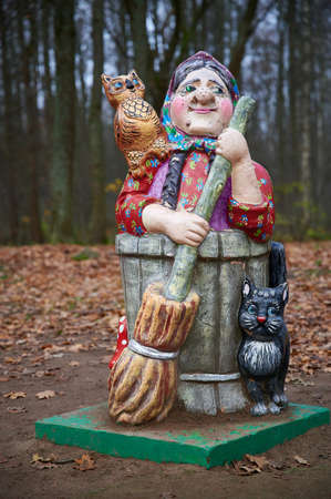 St. Petersburg, Russia - November 4, 2020: Park Dubki in Sestroretsk. Children's playground with sculptures of fairy-tale characters. Old woman with a cat dog and a broom in her hands