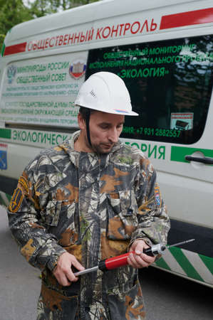 Saint Petersburg, Russia - September 8, 2020: Representative of the state environmental service during air quality measurements for pollution with dioxides, exhaust gases, harmful substances. Control process