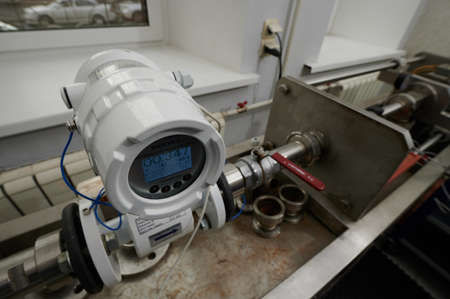 Saint Petersburg, Russia - September 16, 2020: Stand with precisely defined containers of liquids to check the performance and quality of cold and hot water meters Sajtókép
