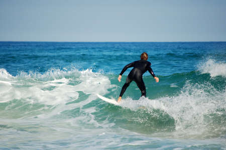 young surfer in ocean photo
