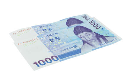 two korean won money notes over white