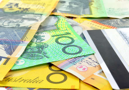 australian money with credit card as a background photo