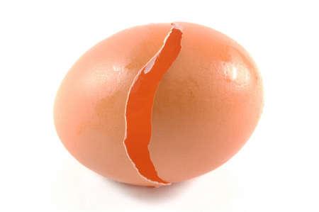 broken egg closeup over white background