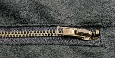 zipper closeup on grey cloth photo
