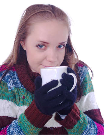 girl in winter clothes with cup of coffee on white photo