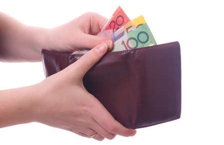 money wallet: female hands holding wallet with australian money