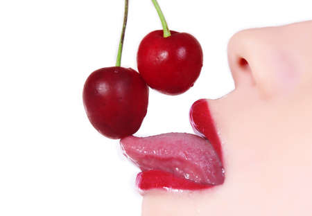 closeup of womans lips with cherry