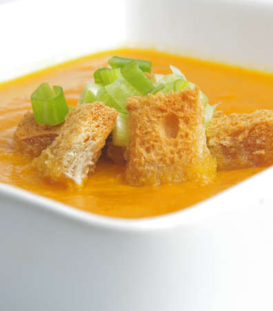 pumpkin soup with crackers and onion