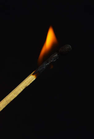 burning match on black background photo