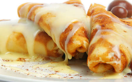 sweet pancakes with cream closeup