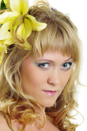 beautiful woman with lily flower in hair photo