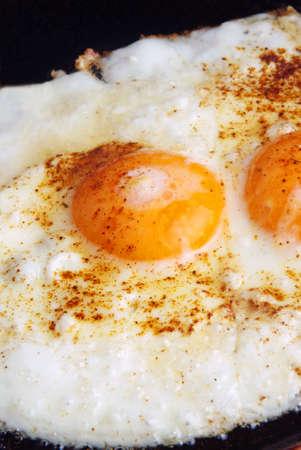 closeup of fried eggs on pan Stock Photo - 12634836