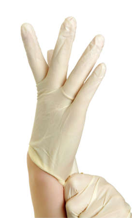 Hand mit medizinischen Handschuhen auf weiß Standard-Bild
