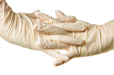 hand with medical gloves on white photo