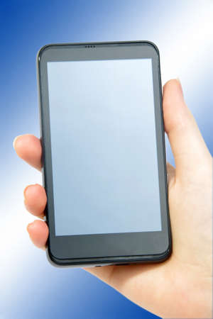 modern smartphone in female hand on blue Stock Photo