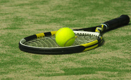 tennis racket with ball on court Stock Photo - 13400352