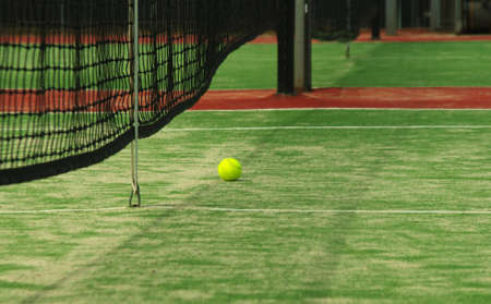 closeup of green tennis court photo