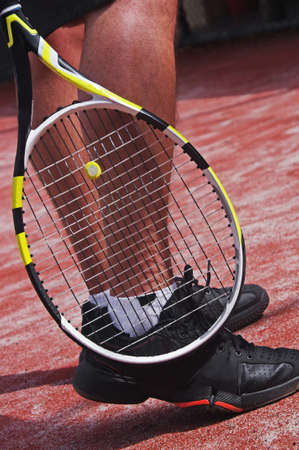 tennis player legs with racket Stock Photo - 13400525