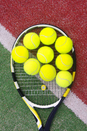 tennis racket with balls on court Stock Photo - 13400547