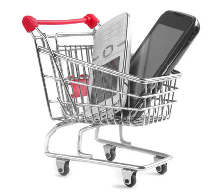 shopping trolley with cell phones isolated on white background Stock Photo - 13400575