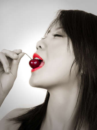 portrait of beautiful fashion asian woman with cherry Stock Photo