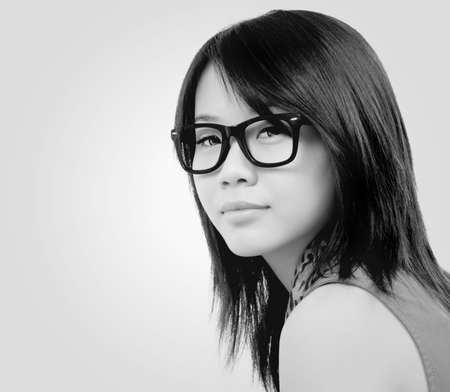 woman wearing glasses: beautiful asian girl with eyeglasses.toned picture