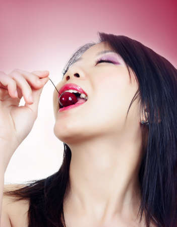 portrait of beautiful fashion asian woman with cherry photo