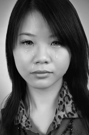 portrait of beautiful crying asian woman.toned picture photo