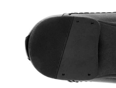 adult footprint: male shoe sole closeup on white Stock Photo
