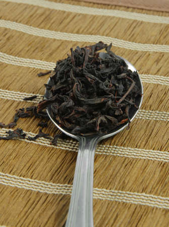 tea leaves on spoon closeup.shallow DOF photo