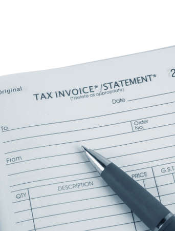 tax invoice book with pen Stock Photo