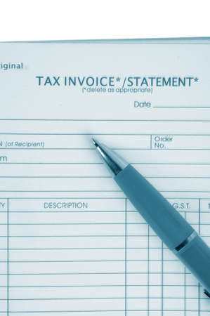 tax invoice book with pen photo