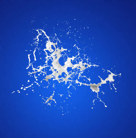 milk splash on the blue surface Stock Photo