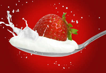 strawberry on the spoon and milk splash photo