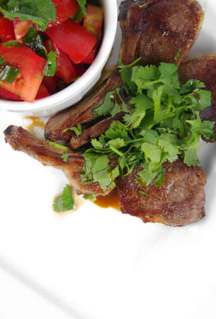boned: bone steaks with coriander on the plate