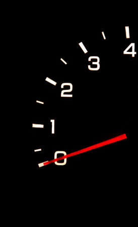 car tachometer closeup in the darkness photo