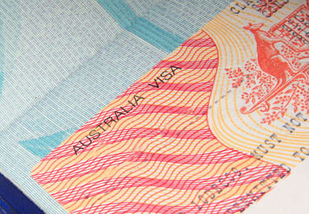 migrations: closeup of australian visa in passport Stock Photo