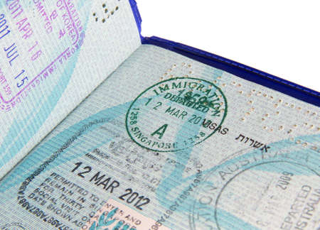 visa stamps in open passport page photo