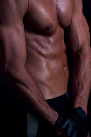 shape of sporty male body on dark photo