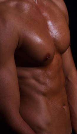 shape of sporty male body on dark photo
