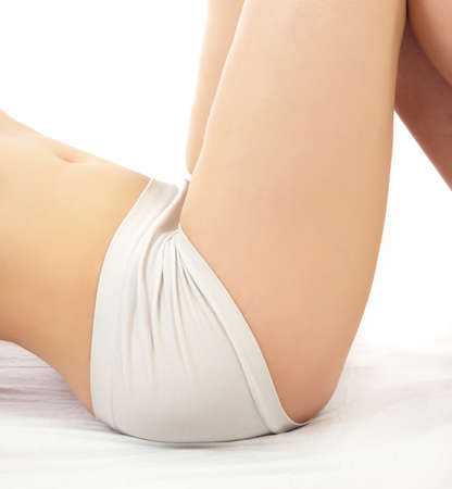 woman buttocks with pants on white photo
