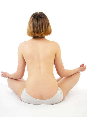bare back blond woman doing yoga photo