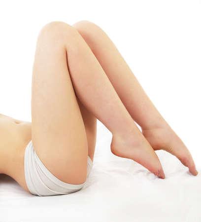 female legs closeup on white photo