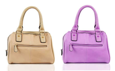 fashionable female bags over white Imagens