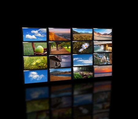 lot of LED TV  over black Stock Photo