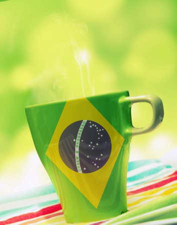 mondial: mug with hot drinkand Brazil flag  Stock Photo