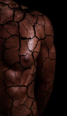 sporty male body with cracks. drought concept photo