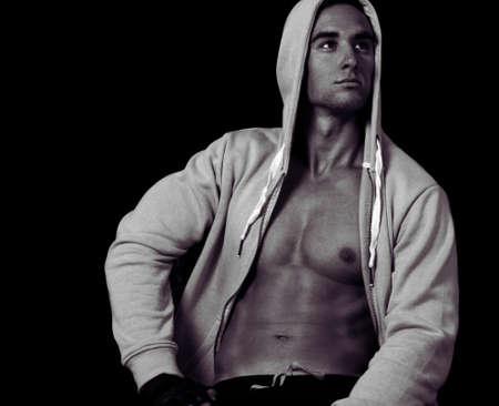 hombre fuerte: Hombre fuerte hermoso con la chaqueta Foto de archivo