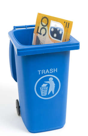 rubbish bin with australian money isolated on white