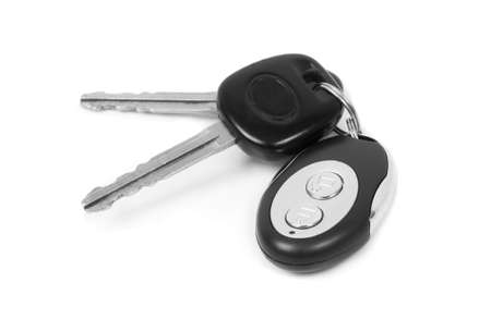 car keys and  remote control on white photo